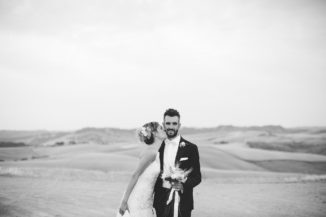 wedding photographer countryside tuscany italy bw kiss groom destination bride hills