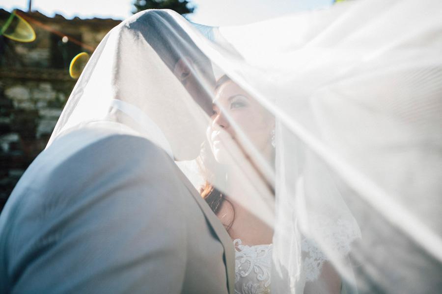 bride groom portrait sun flare tuscany destination castle vicchi
