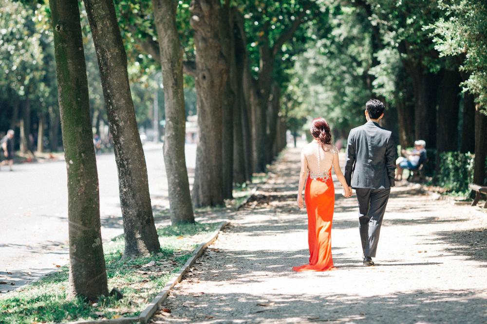 couple walking park villa borghese destination wedding engagemen