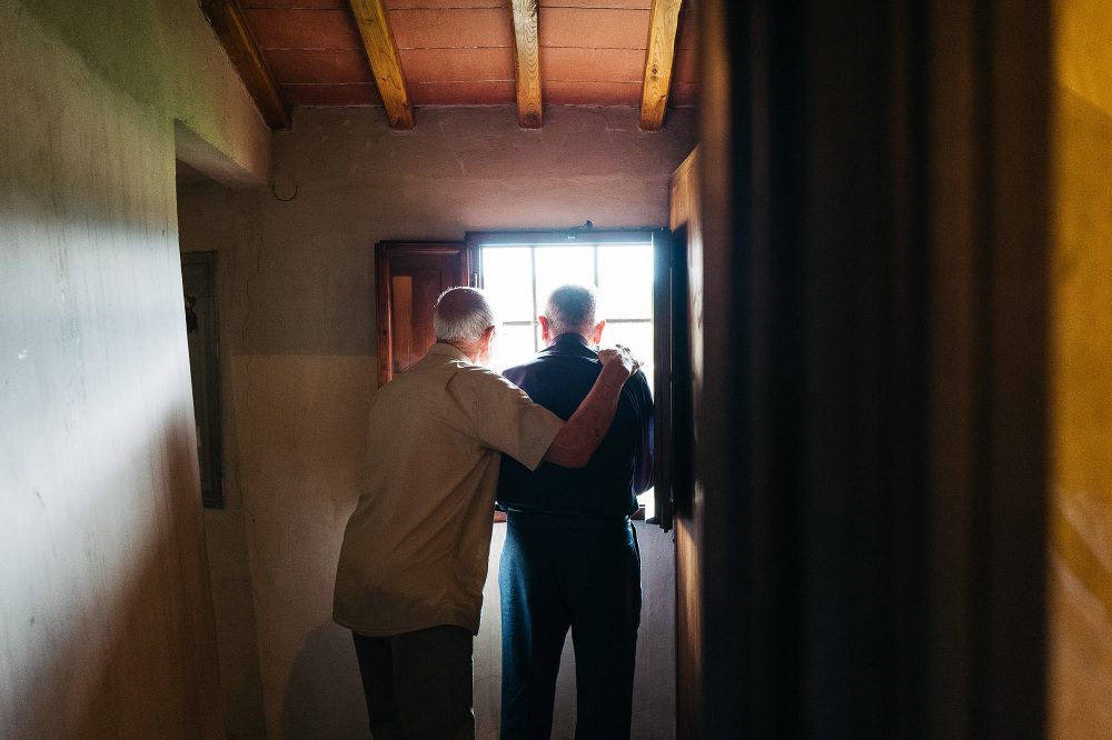 wedding photographer fiesole tuscany photo priest church hug